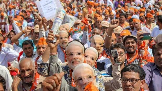 BJP Supporters Raising the Narendra Modi Masks in a Rally