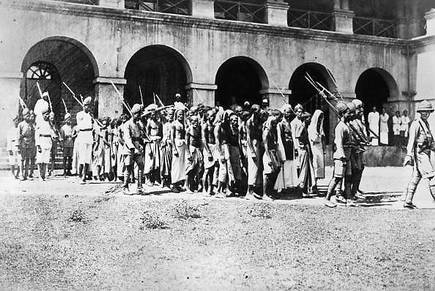 "A picture by Topical Press Agency/Getty Images, captioned September 26, 1925: ""Moplah prisoners go to trial at Calicut on the Malabar Coast in India's south-western state of Kerala, charged with agitation against British rule in India."""